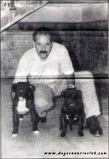 Manuel Moreno Miranda with two pups