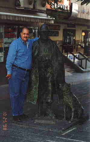 Dr. Gallardo in Tenerife, with a statue of a farmer with a Perro de Presa